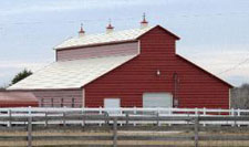 Raised center aisle barn