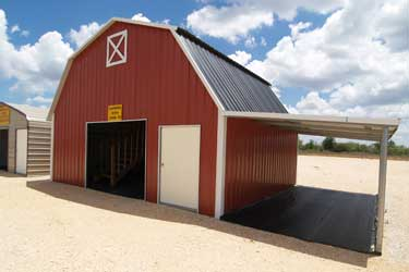 Red gambrel barn with lean-to